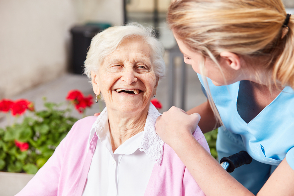 geriatrics photo - lady smiling at homecare nurse